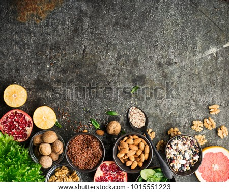 Ingredients of a healthy diet for drawing up a meal plan: wild brown rice, quinoa, spinach, legumes, oranges, grapefruit, almonds, walnuts. Top View #1015551223