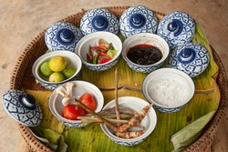 Ingredients of traditional Thai spicy soup Tom Yum Kung in typical blue asian bowls