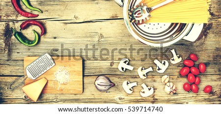Ingredients on a wooden table. Ingredients for cooking pasta, spaghetti, fettuccine, closeup,