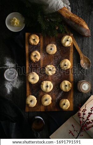 Ingredients surround delicious shortbread cookies ready to serve on an old walnut cutting board during the holidays