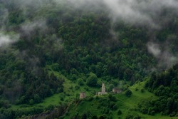 Ingush combat towers were designed for defense. Khart medieval tower complex has the 4 level combat tower and the residential buildings, a few crypts are located on the mountain range nearby