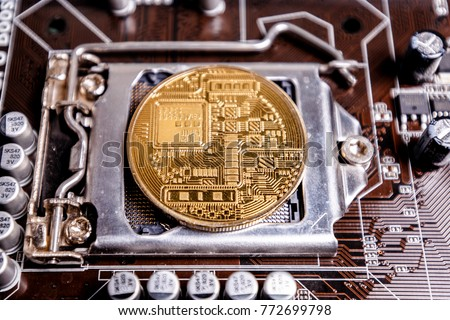Initial coin offering as a concept. In the center of a computer printed circuit board the Bitcoin coin as an ICO procedure
