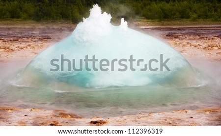 Initial phase of an eruption of Strokkur, famous Icelandic geyser