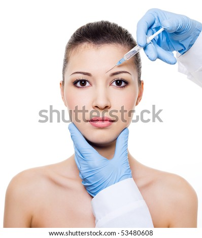 Injection in the eyebrow on female face - isolated on white
