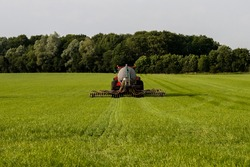 Injection of liquid manure with an liquid manure spreader in the Netherlands.