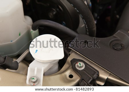 Injection water for glass, component of car engine - stock photo