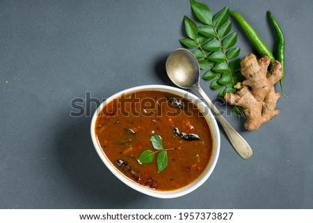 Inji puli or Puli Inji_Kerala traditional feast side dish made using tamarind ,ginger and green chilli arranged in a white table ware with grey colour background. Zdjęcia stock ©