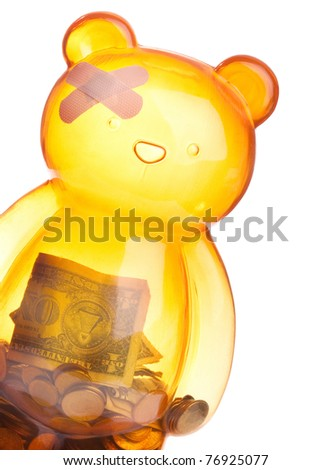 Injured bear  or piggy bank isolated on white depicting financial crisis, regression, economic trouble and more