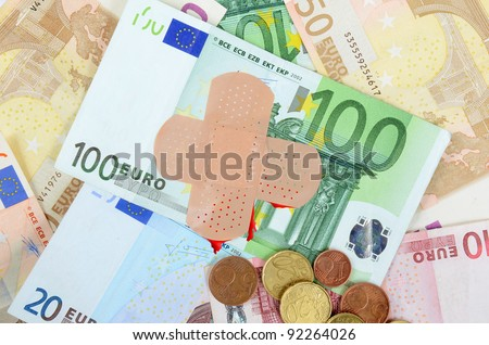 Injured euro money with a band-aid