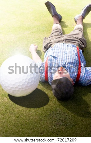 Injured Golfer Gets Hit And Knocked On To His Back By An Enormous Golf Ball In A Sport Injury Of Hilarious Proportions Titled Golfer Didnt See That One Coming