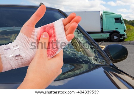 Injured isolated hand tied up by white bandage at car accident  #404339539
