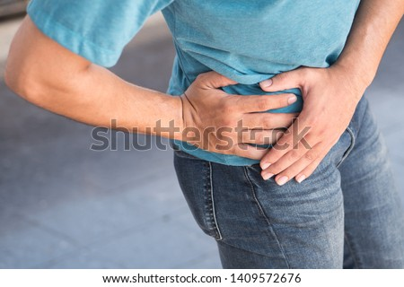 injured man suffering from pelvic pain or hip joint injury