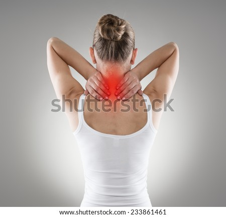 Injured neck. Young female suffering from spine disease. Inflammation, pain and treatment.