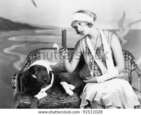 Injured woman and injured dog sitting on a couch