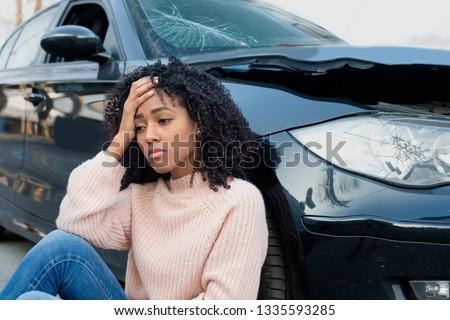 Injured woman feeling bad after having a car crash #1335593285