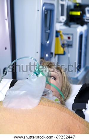 Injured Woman With Oxygen Mask, ambulance interior