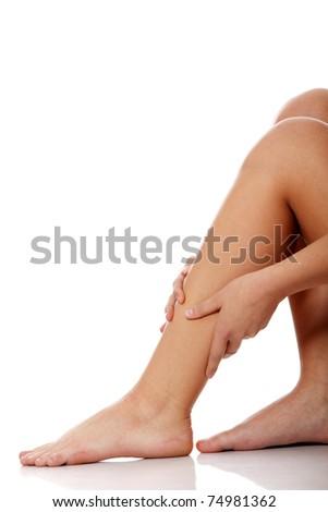 Injury. Woman holding on leg.