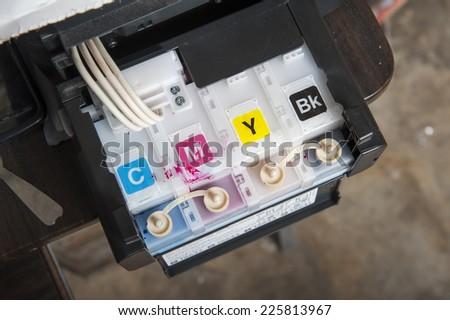 Ink jet printer cartridge refilling