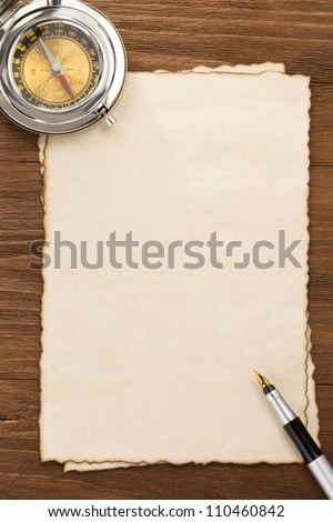 ink pen and compass on parchment background texture