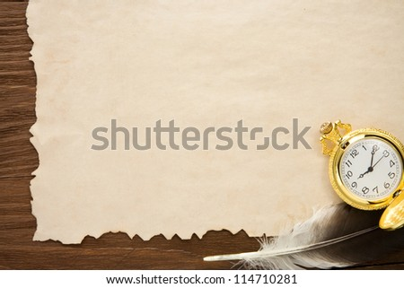 ink pen and watch on parchment background texture