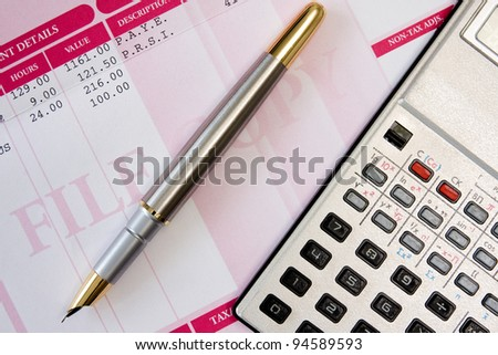 ink pen,calculator  and payroll summary details
