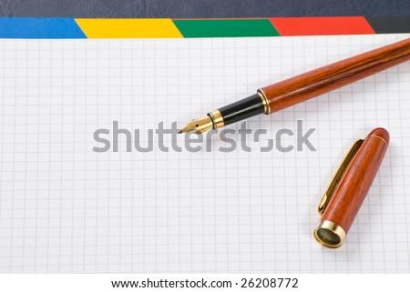 ink pen on notebook
