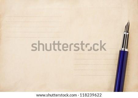 ink pen on old postal envelope background