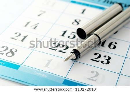 ink pen to mark the date in the calendar