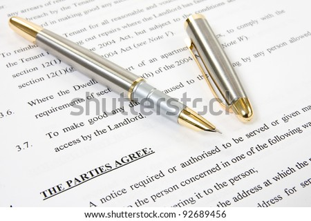 ink pen with agreement between landlord and tenant