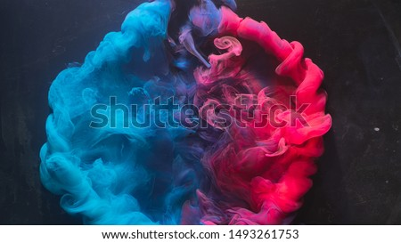 Photo of  Ink water explosion. Harmony balance. Blue pink acrylic paint spill. Abstract art background.
