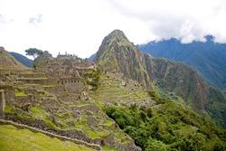 INKA RUINS OF MACHUA PICCHU LOOKING TOWARDS WAYNA PICCHU IN PERU