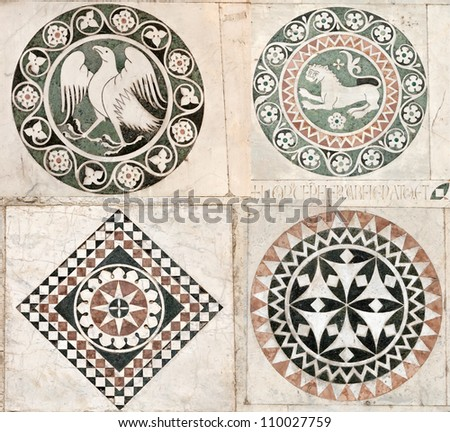 Inlaid marble ornaments on the walls of the 12th century Cathedral of St Martin in Lucca, Italy