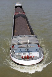 inland general cargo vessel shipping on the river Rhine in Cologne/ Germany
