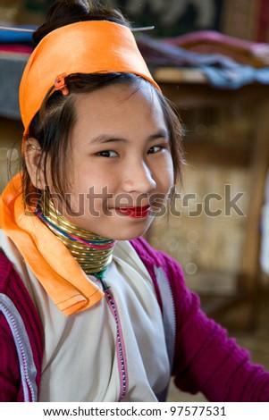 INLE LAKE, MYANMAR - FEBRUARY 23: Unidentified Padaung tribe girl on February 23, 2011 in  Inle Lake, Myanmar. The Padaung-Karen long-necked tribe women are minority of Myanmar.