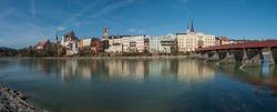 Inn by the river Wasserburg city skyline with bridge.