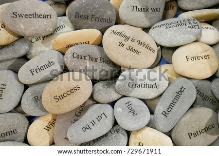 Inner balance concept, stone with the word success,hope,let it be,remember,patience,friends,gratitude,forever,sweetheart,thank you and count your blessing.