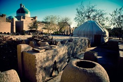 Inner courtyard of the town. In the foreground is a clay oven. Khiva City, Central Asia, Uzbekistan.