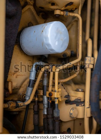 Inner machinery of an old bulldozer - close up photo of pipes, hoses and connectors