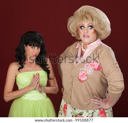 Innocent looking woman and disgusted drag queen