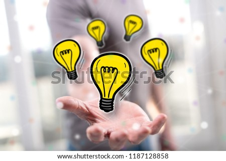 Innovation concept above the hand of a man in background