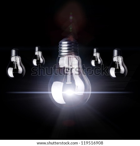 Innovation concept with light bulbs on a black background