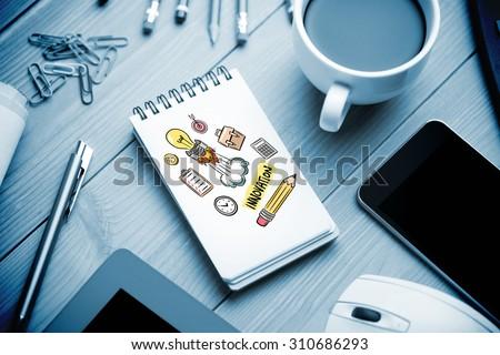 innovation doodle against notepad on desk