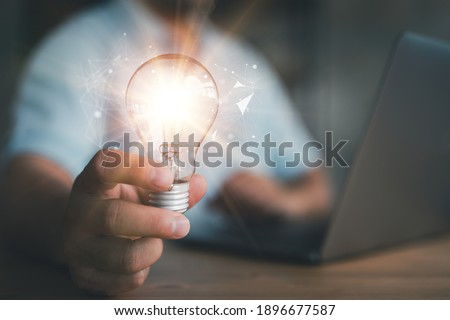 Innovation. Hands holding light bulb for Concept new idea concept with innovation and inspiration, innovative technology in science and communication concept,