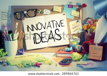 Innovative Ideas / Business innovation concept in messy office interior