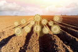 Innovative technology pictogram on a spring farm field. Development of technology improvements for increased the farming season by planting more resistant plant crops.
