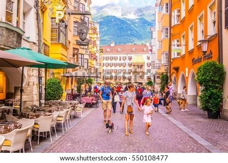 INNSBRUCK, AUSTRIA, JULY 27, 2016: People are wandering around the historical center of Innsbruck, Austria #550108477