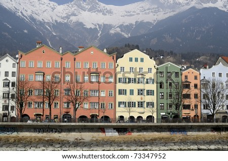 Innsbruck, Tirol - colorful building in front of the snowy mountains