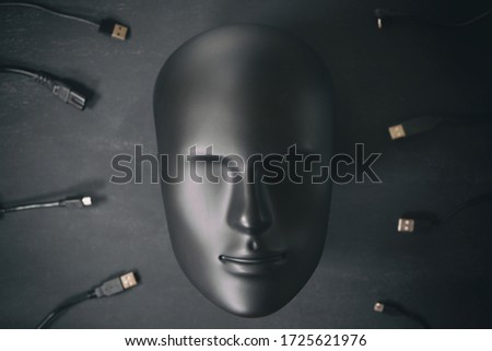 Inorganic human robot  face connected with many digital device wires cables chargers. Digitalization, chipization, artificial intelligence, futuristic cyborg concept in total black color. Stock fotó ©