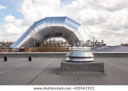 inox Chimney on the flat roof in the city #430561921
