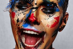 Insane laughing evil Clown with creative Face Art